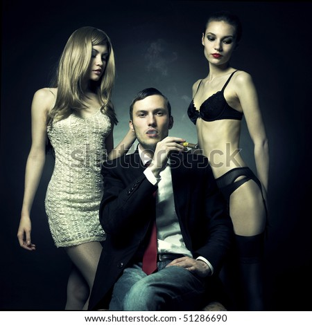 Fashion photo of handsome man and two women