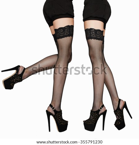 fashion photo of long sexy woman legs in stockings.beauty female legs in high heels.black short skirt isolate collage girls - stock photo