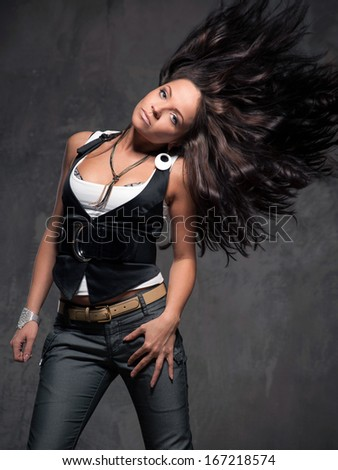 Fashion photo of sensual woman wearing trousers and vest