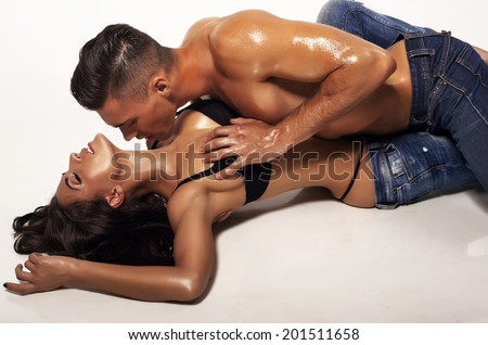 fashion photo of sexy impassioned couple wearing jeans - stock photo