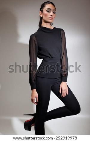 Fashion photo of young magnificent woman. Girl posing. Attractive sexy brunette woman posing.Studio photo - stock photo