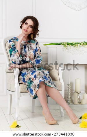 Fashion photo of young magnificent woman. Girl posing. Studio photo. Portrait of beautiful brunette woman