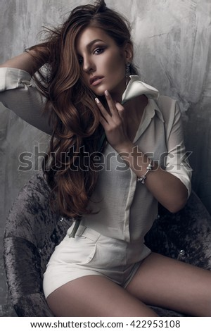 Fashion photo of young magnificent woman. Girl posing with a flower. Studio photo. beautiful girl studio white clothing - stock photo