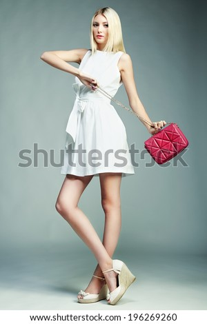 Fashion photo of young magnificent woman. Girl with handbag. Girl posing - stock photo