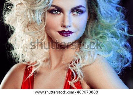 Fashion photo of young magnificent woman with luxurious styling. Studio portrait