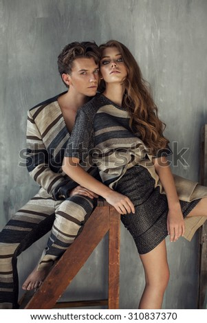Fashion photo of young models hugging each other - stock photo