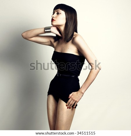Fashion photo of young slender woman in fashionable swimsuit