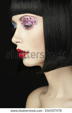 Fashion photo of young woman with dark hair. Woman in black wig - stock photo