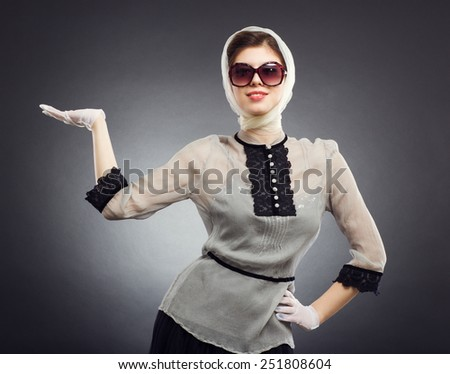 Fashion photo. Portrait of a beautiful woman wearing sunglasses in a retro style. - stock photo