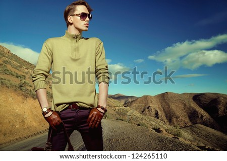 Fashion photo shot of a man wearing gloves - stock photo