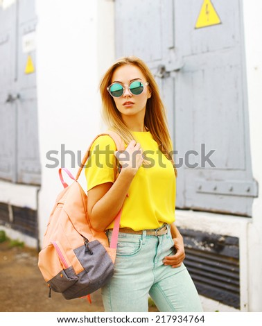 Fashion photo stylish hipster woman in sunglasses posing in the city, street fashion - stock photo