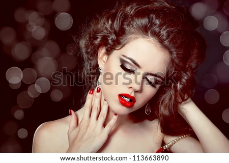 Fashion photo woman Portrait. Red Lips on glitter background. - stock photo