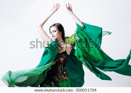 Fashion photo  young magnificent woman in green dress,  the image of nature. Studio portrait - stock photo