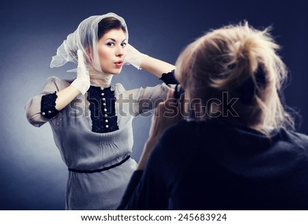 Fashion photographer and model working together - stock photo