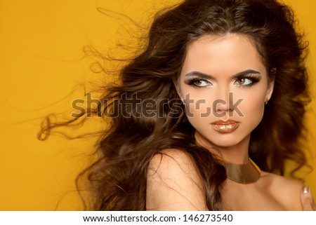 Fashion Portrait. Beauty Woman with Very Long Healthy and Shiny Curly Brown Hair.  - stock photo