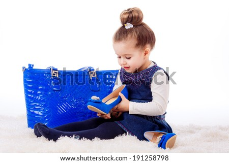 fashion portrait.  girl with shoes and bag mom. isolated on white background. fashionista, shopping