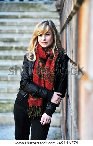 Fashion Portrait Leaning Against Wall - stock photo