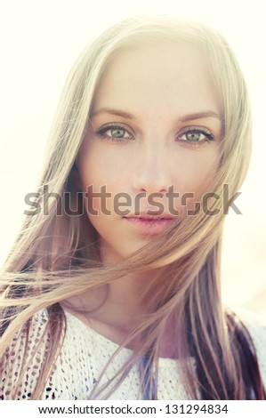 fashion portrait of a beautiful blonde close up. pictures in warm colors - stock photo