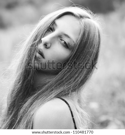 fashion portrait of a beautiful girl. black and white photo