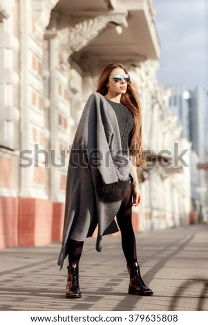 fashion portrait of a beautiful girl on the streets - stock photo