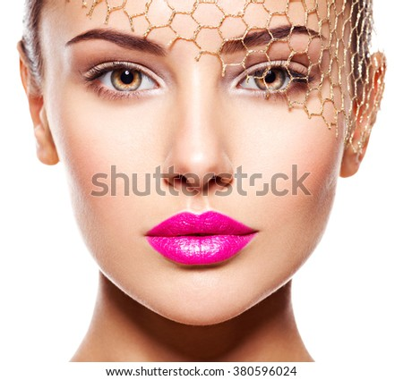 Fashion portrait of a beautiful  girl wears golden veil on face. pink lips. Isolated on white background - stock photo