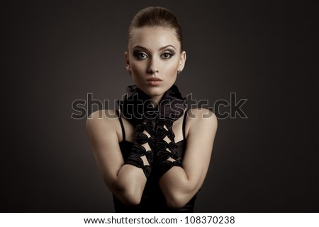 Fashion Portrait of a beautiful woman  in black retro gloves - stock photo