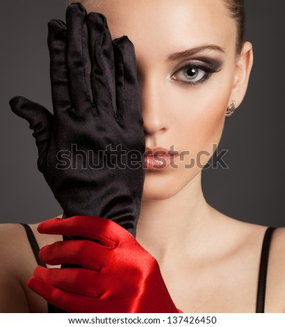 Fashion Portrait of a beautiful woman in gloves - stock photo