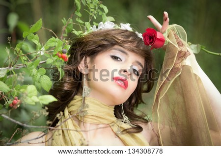 Fashion portrait of a beautiful Woman with berries in her hands - stock photo