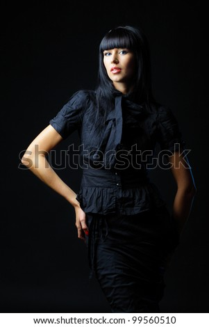 Fashion portrait of a beautiful young sexy woman in black clothing - stock photo