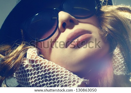 Fashion portrait of a beautiful young sexy woman wearing sunglasses - stock photo