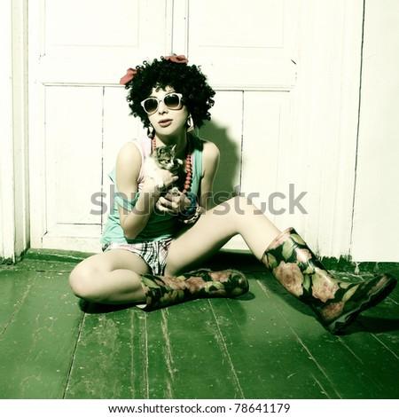 Fashion portrait of a beautiful young sexy woman wearing sunglasses. - stock photo