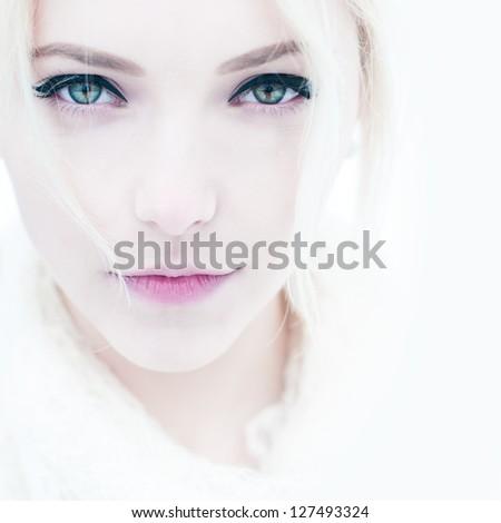 fashion portrait of a beautiful young woman close up - stock photo