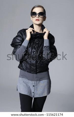 Fashion portrait of a beautiful young woman wearing sunglasses - stock photo