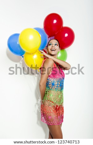 Fashion portrait of a beautiful young women posing with ballons, isolated on white