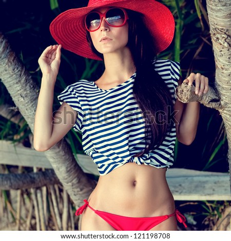 fashion portrait of a girl in the tropics - stock photo