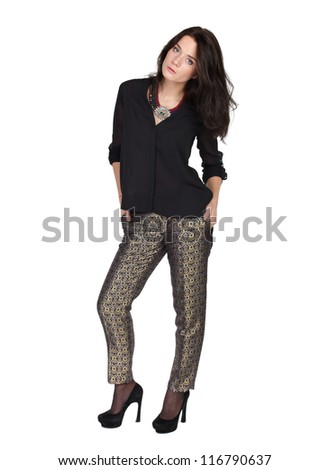 fashion portrait of a girl in trousers and a black blouse