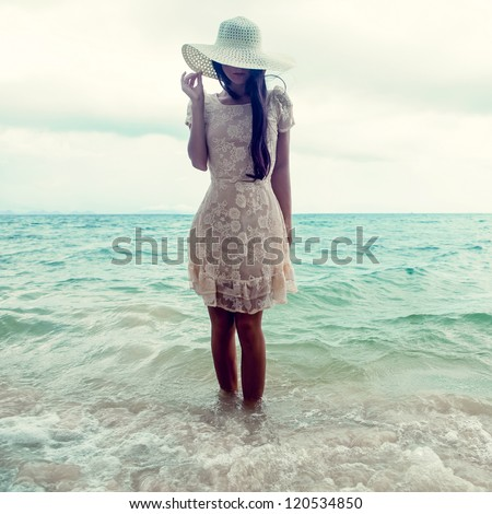 fashion portrait of a girl on the sea - stock photo