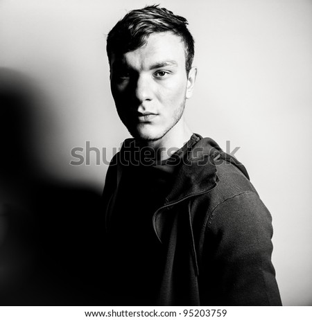 Fashion portrait of a handsome young man - stock photo