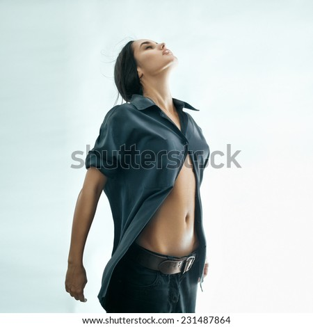 Fashion portrait of a jumping brunette model. Flying. Enjoyment. - stock photo