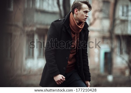 fashion portrait of a stylish man posing outside, autumn time