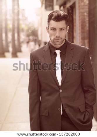 Fashion portrait of a well dressed good-looking man outdoors - stock photo