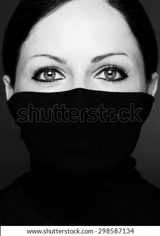 Fashion portrait of a woman with black polo neck Look at woman eyes  Black and white photo