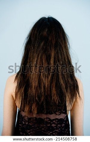 fashion portrait of a woman with long and curly hair,Young beautiful woman combing her luxuriant hair - stock photo