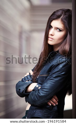 fashion portrait of a young adult girl, toned image - stock photo