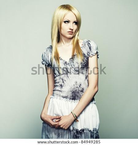 Fashion portrait of a young beautiful blonde woman - stock photo