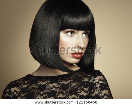 Fashion portrait of a young beautiful dark-haired woman. Vintage style - stock photo
