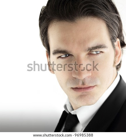 Fashion portrait of a young sexy male model in business wear against bright modern background - stock photo