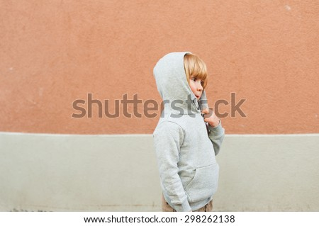 Fashion portrait of adorable toddler boy wearing grey sweatshirt - stock photo