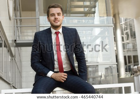 Fashion portrait of an handsome businessman in an urban setting