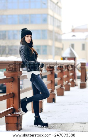 Fashion portrait of attractive young woman in winter. Full length - stock photo